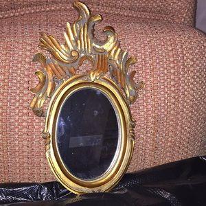 Antique gold accent mirror.